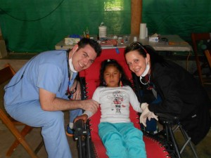 Gabe and Courtney working with their patient