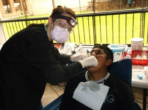 Courtney finishing a cleaning with some flossing.